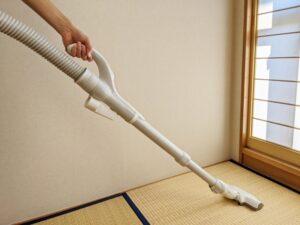 Clean tatami room with vacuum cleaner